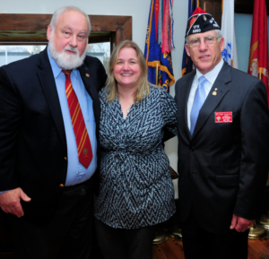 Marine Sgt. Paul Haines (left) was honored as a Hometown Hero by the Westhampton Free Library at a ceremony at the Westhampton VFW Post on April 27. He is pictured with Westhampton Free Library Director Danielle Waskiewicz and VFW Commander William Hughes.